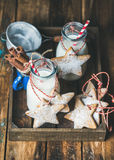 Bottles with milk for Santa and Christmas homemade gingerbread biscuits Stock Photo