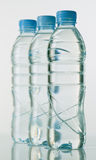 Bottles of mineral water on white base Stock Photos