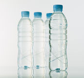 Bottles of mineral water on white base Stock Photography