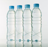 Bottles of mineral water on white base Royalty Free Stock Photo