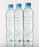 Bottles of mineral water on white base Royalty Free Stock Photos
