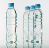 Bottles of mineral water on white base Royalty Free Stock Images
