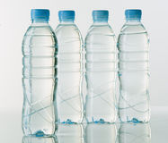 Bottles of mineral water on white base Royalty Free Stock Image