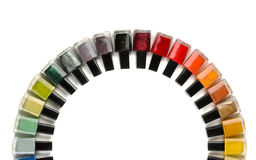 Bottles with nail polish arranged in a semicircle. Stock Image