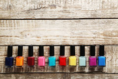 Bottles of nail polish. On a grey wooden table Stock Photos