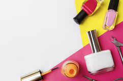 Bottles of nail polish. Orange, pink and white color. Royalty Free Stock Photos