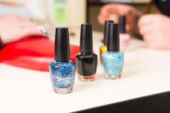 Bottles of Nail Polish on Salon Manicure Table Stock Photos