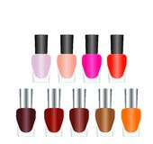 Bottles of nail polish in various bright colors Stock Images