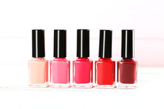 Bottles of nail polish. On a wooden table Royalty Free Stock Photography