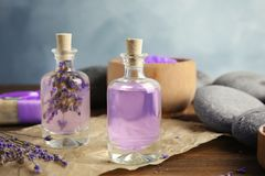 Bottles with natural herbal oil and lavender flowers royalty free stock photography
