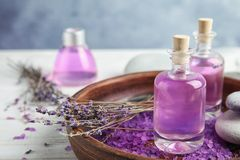 Bottles with natural herbal oil and lavender flowers stock image