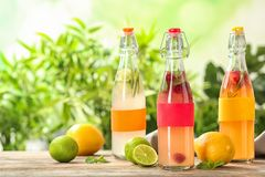 Bottles with natural lemonade on tabl stock photo