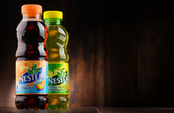 Bottles of Nestea ice tea produced by Nestle. POZNAN, POLAND - JAN 18, 2017: Nestea is a brand of iced tea manufactured by Coca-Cola and distributed by Nestle Royalty Free Stock Photography