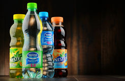Bottles of Nestle drink brands. POZNAN, POLAND - JAN 18, 2017: Nestle is a transnational food and drink company headquartered in Vevey, Vaud, Switzerland. Among Royalty Free Stock Images