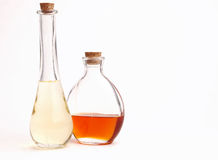 Bottles of Oil. Fancy bottles filled with different colored vegetable oils Royalty Free Stock Image