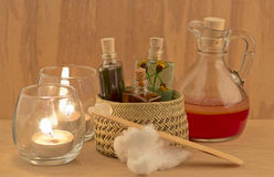 Bottles of Oil over wood board. And candle Stock Photography