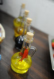 Bottles with oil seasoning Stock Photos
