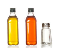 Bottles of oil, vinegar and salt boat Stock Images
