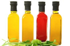 Bottles of Olive Oil. Bottles of different flavoured olive oil royalty free stock photo