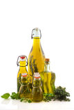Bottles olive oil with herbs Stock Photos