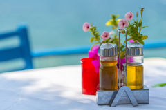Bottles of Olive Oil And Vinegar On The Table in Greece Royalty Free Stock Photos