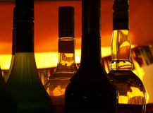 Bottles in an orange backlight Stock Photography