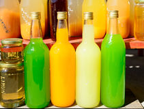 Bottles of orange juice and lemon Royalty Free Stock Photo