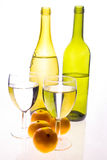 Bottles and oranges. Healthy still life of water/wine bottles and oranges Royalty Free Stock Images