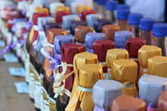 Natural products. In bottles wrapped with colored paper Royalty Free Stock Photos