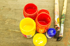 Bottles  paint and brushes Stock Image