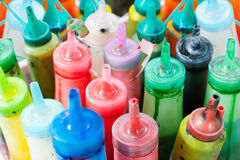 Bottles of paint. Many bottles of watercolour paint, narrow focus royalty free stock photos