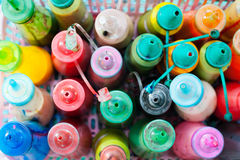 Bottles of paint. Many bottles of watercolour paint, narrow focus, top view royalty free stock photography