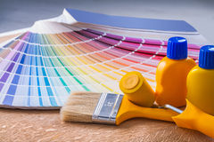 Bottles of paint paintbrush paintroller color. Palette Stock Photo