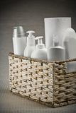 Bottles and paper towel in basket Stock Photo