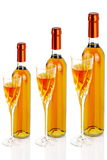 Bottles of passito wine with chlicea. Bottles of passito wine with wine glasses on white background Stock Photos