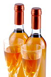 Bottles of passito wine with goblets. On white background Stock Image