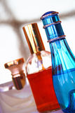 Bottles of perfume. This image represents three bottles of perfume in different colors Royalty Free Stock Photo