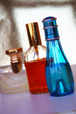 Bottles of perfume. This image represents three bottles of perfume in different colors Royalty Free Stock Images