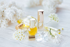 Bottles of perfume with flowers royalty free stock photos