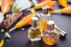 Bottles of perfume with ingredients. On paper Stock Photo