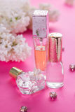 Bottles of perfume with lilac Royalty Free Stock Images