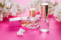 Bottles of perfume with lilac Royalty Free Stock Photos