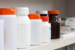 Bottles on pharmacy store shelf Stock Photography
