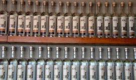 Bottles of Pisco Near Paracas. Bottles of Pisco on display at aa vineyard/distillery near Paracas, Peru stock photo