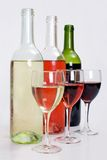 Bottles of red, white and rose wine with glasses Stock Photo