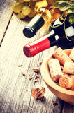 Bottles of red and white wine with bunch of corks Royalty Free Stock Photography