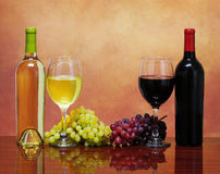 Bottles of Red and White Wine with Fresh Grapes. Royalty Free Stock Photo