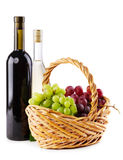 Bottles of red and white wine with grapes Royalty Free Stock Photography