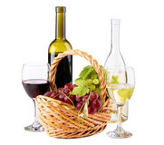 Bottles of red and white wine with grapes Stock Photos