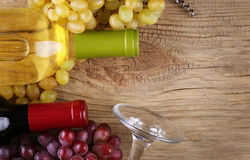 Bottles of red and white wine on old wood Royalty Free Stock Images